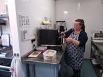 Emma using the coffee machine